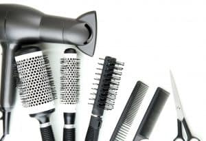 Comb brushes, hairdryer and cutting shears, isolated on white