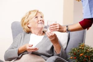 Home caregiver with old patient