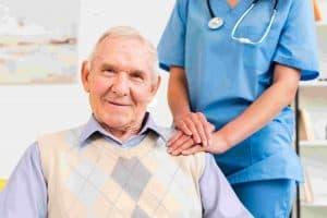 caregiver-holding-old-man-s-shoulder